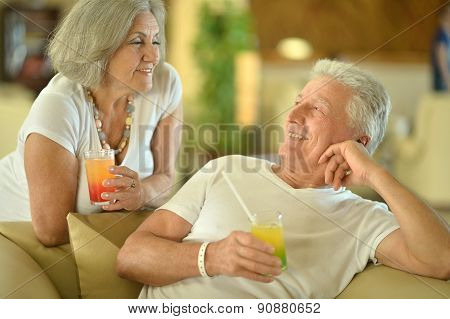 Old couple drink juice