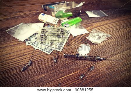 Drugs, Money, Needles And Syringes.