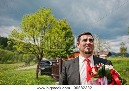 Groom On The Background Of The Cloudy Sky