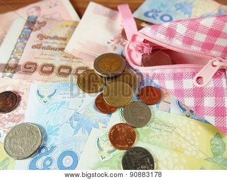 Coins And Banknotes Of Thai Baht Money Background With Pink And White Purse
