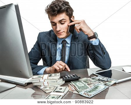 Successful Businessman Going To Make A Call By Cellphone While Working With Pc Computer And Calculat