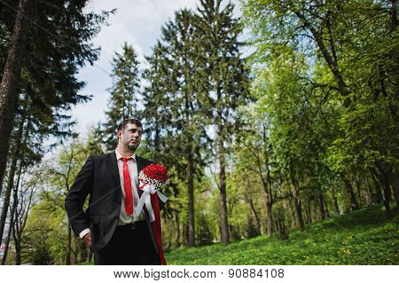 Portrait Of Groom In The Forest