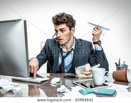 Office Worker With Paper Plane In His Hand Typing On A Computer Keyboard