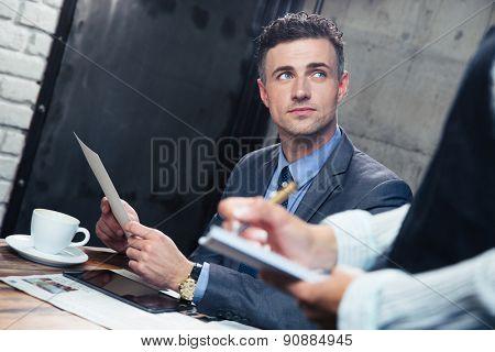 Confident man making order at restaurant