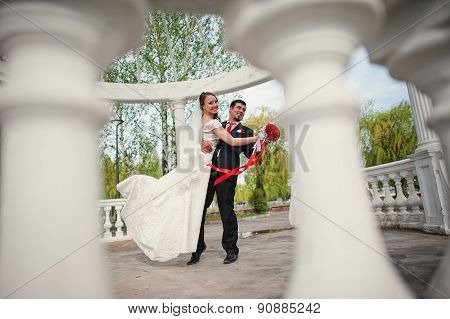 Wedding Couple Under The Arch