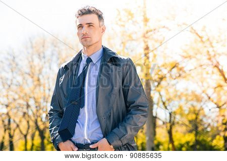 Portrait of a confident pensive businessman outdoors. Looking away