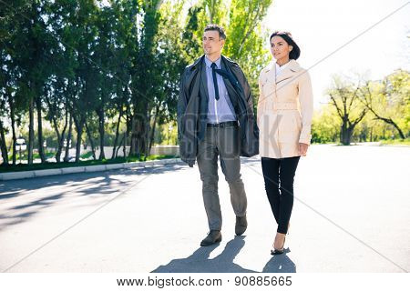 Portrait of a beautiful couple walking in park