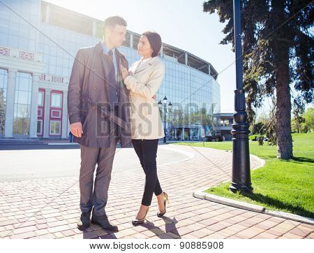 Full length portrait of a happy couple standing outdoors