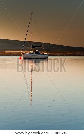 Sail Boat In Dawn Light