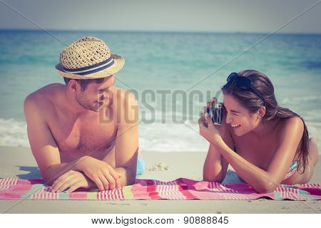 happy couple taking photo at the beach