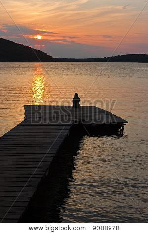 Woman On Pier With Sunset