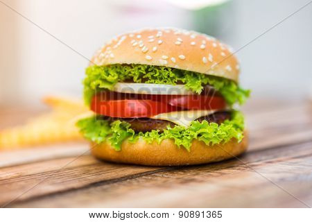 Hamburger on wood table ,sun flare filter effect