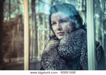 Glamour, Russian woman in fur coat in a park in autumn