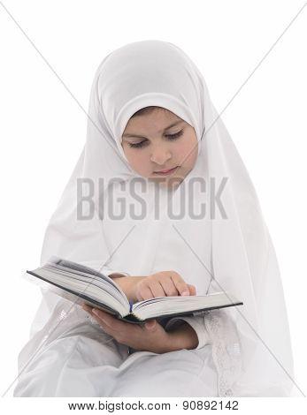 Young Muslim Girl Reading Quran