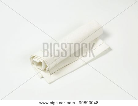 rolled up white place mat on white background