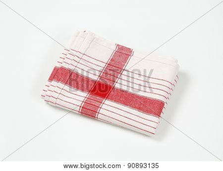 red and white striped dishtowel on white background