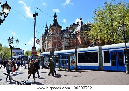 Amsterdam, Netherlands - May 6, 2015: People Around Stadsschouwburg Building