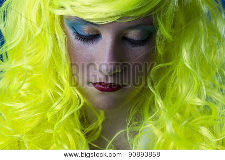 Sad, young girl with yellow hair
