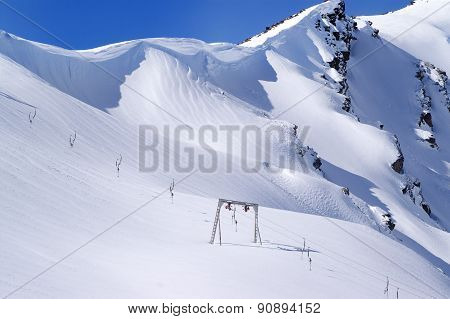 Old Surface Lift And Mountains With Snow Cornice