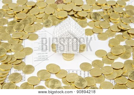 House On Pile Of Gold Coins Have Gold Coins Around
