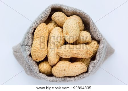 Isolated peanuts (groundnuts) in the linen bag