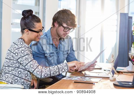 Professional designers working on photos in the office