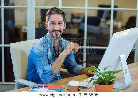 Casual businessman working at his desk in the office
