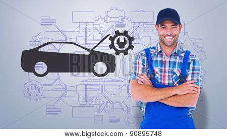Male handyman standing arms crossed over white background against grey vignette