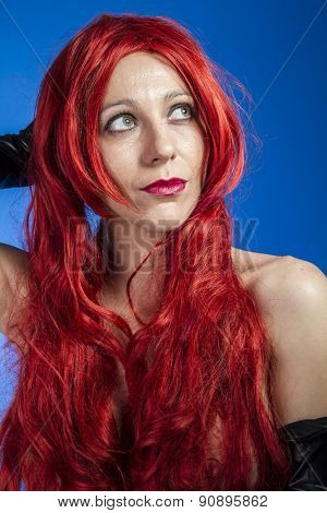 Haircare, attractive woman with huge red mane, blue chroma