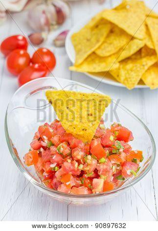 Bowl Of Fresh Homemade Salsa Dip With Nachos