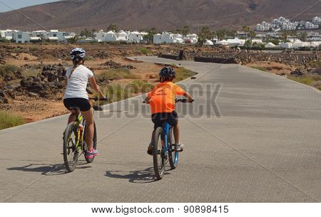 Holiday makers cycling