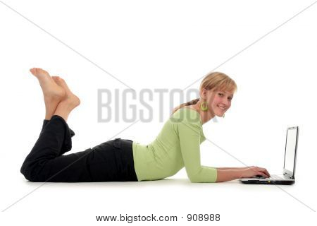 Young Woman Lying On Floor Using Laptop