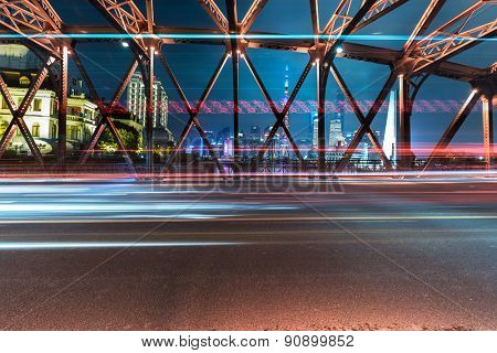 Night traffic lights inside of the Garden Bridge of shanghai china.
