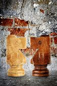 picture of knights  - grunge style of wooden chess knights as rivals - JPG