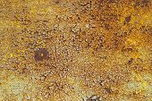 stock photo of goldenrod  - rusty iron surface covered with old paint - JPG