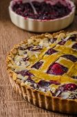 foto of tarts  - Shortbread tart with cherries with beautiful grid sprinkled with almonds - JPG