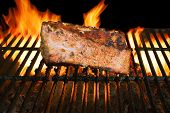 picture of flame-grilled  - BBQ Grilled Pork Ribs On The Hot Flaming Grill Close - JPG