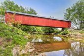 pic of covered bridge  - The historic red James Covered Bridge crosses Big Graham Creek in rural Jennings County Indiana - JPG