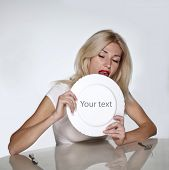 picture of licking  - Blond woman licking white plate - JPG