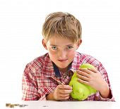 picture of thrift store  - The boy gets money from the piggy bank - JPG