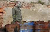 pic of nuclear disaster  - Man with gas mask and green military clothes after chemical disaster - JPG