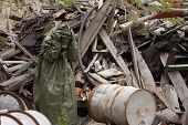 stock photo of gas mask  - Man with gas mask and green military clothes after chemical disaster - JPG