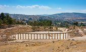 picture of cardo  - Ruins of the Forum Cardo at Jerash Jordan with modern city view - JPG