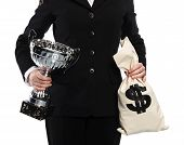 pic of money prize  - businesswoman holding trophy and money bag isolated on a white background - JPG