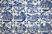 image of biblical  - Close up of antique tin glazed blue Delft wall tiles dating from 1750 - JPG