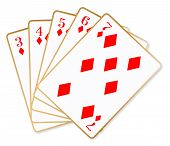stock photo of poker hand  - The poker hand straight flush over a white background - JPG