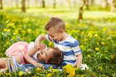 stock photo of orchard  - Girl lying with the boy in a blossoming orchard - JPG