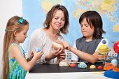 picture of earth mars jupiter saturn uranus  - Kids and teacher in science class study the solar system  - JPG