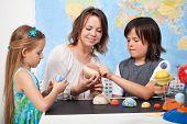 stock photo of earth mars jupiter saturn uranus  - Kids and teacher in science class study the solar system  - JPG