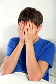 picture of sorrow  - Tearful and Sorrowful Teenager in the Bed at the Home - JPG